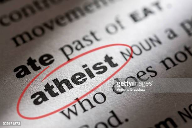 dictionary entry for the word athiest - atheism stock photos and pictures