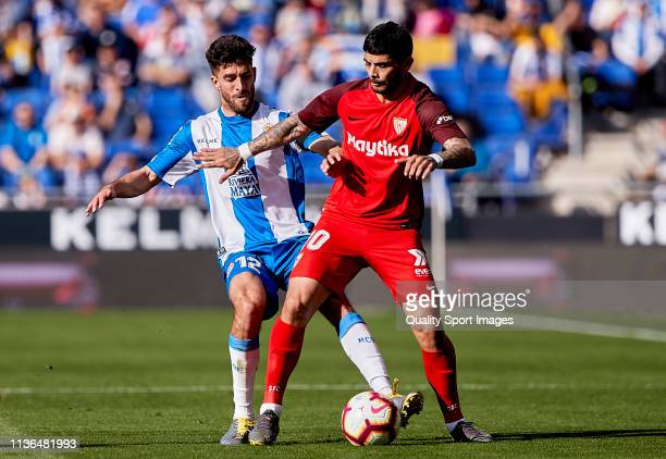 Didac Vila of RCD Espanyol competes for the ball against Ever Banega of Sevilla FC during the La Liga match between RCD Espanyol and Sevilla FC at...