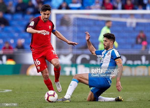 Didac Vila of RCD Espanyol competes for the ball against Jesus Navas of Sevilla FC during the La Liga match between RCD Espanyol and Sevilla FC at...