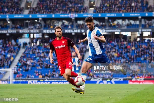Didac Vila of RCD Espanyol plays the ball under pressure from Franco Vazquez of Sevilla FC during the La Liga match between RCD Espanyol and Sevilla...