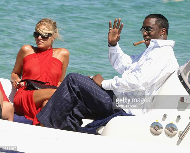 Diddy and his friends relaxs in a boat off the beach of Club 55 on July 27 2003 in St Tropez France Every year prominent members of the the...