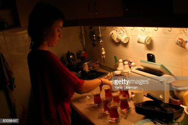 Didem prepares Chaii at a friends place during an after party in the early morning of October 23 2004 in IstanbulTurkey The Flowers of Istanbul are a...