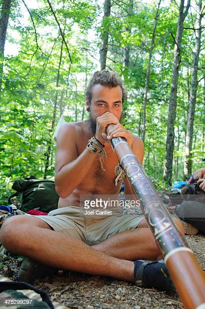 Didgeridoo in the forest at Rainbow Gathering