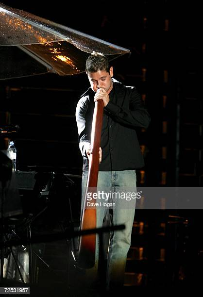 A didgeridoo player performs on stage with U2 at the first of three rescheduled Sydney dates on their Vertigo Tour at the Telstra Stadium on November...