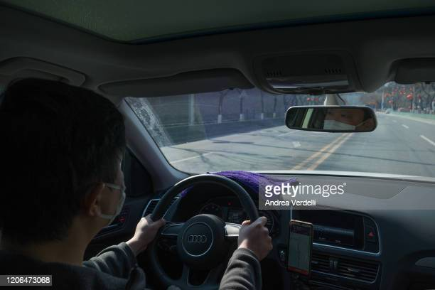 Didi driver wears a mask while driving on February 15 2020 in Beijing China