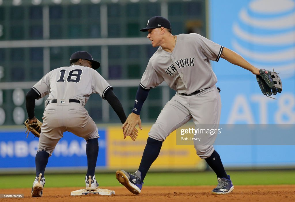 Didi Gregorius #18 and Aaron Judge #99 of the New York Yankees celebrate after defeating the Houston Astros 4-0 at Minute Maid Park on May 1, 2018 in Houston, Texas.