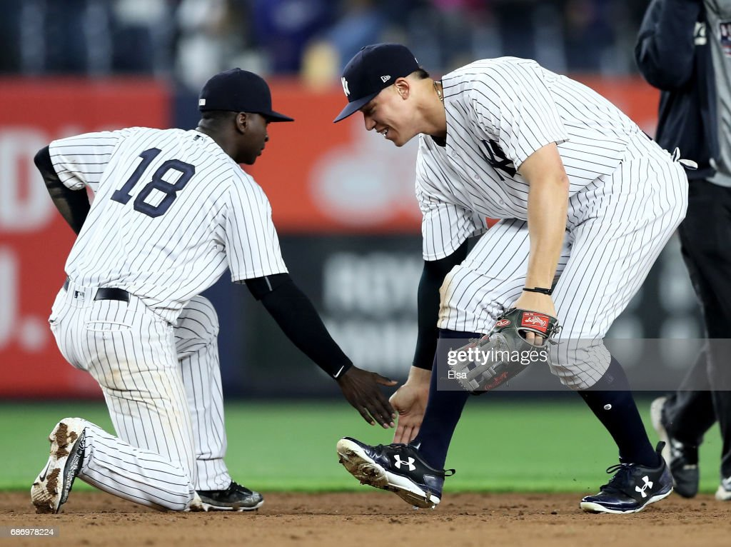 Didi Gregorius #18 and Aaron Judge #99 of the New York Yankees celebrate the 4-2 win over the Kansas City Royals on May 22, 2017 at Yankee Stadium in the Bronx borough of New York City.