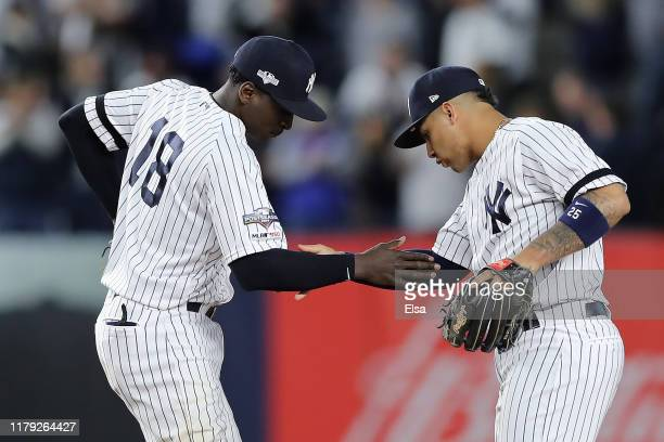 Didi Gregorius and Gleyber Torres of the New York Yankees celebrate their 82 win over the Minnesota Twins in game two of the American League Division...