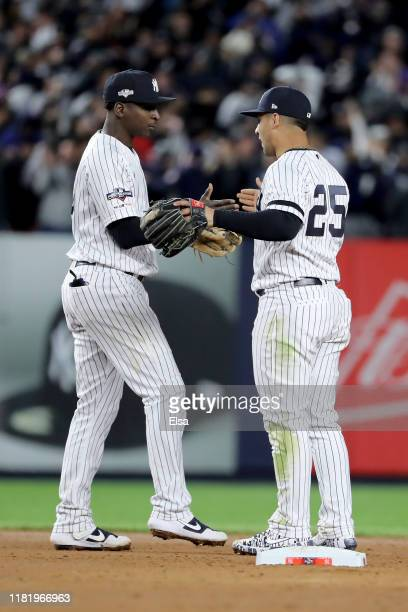 Didi Gregorius and Gleyber Torres of the New York Yankees celebrate after defeating the Houston Astros in game five of the American League...