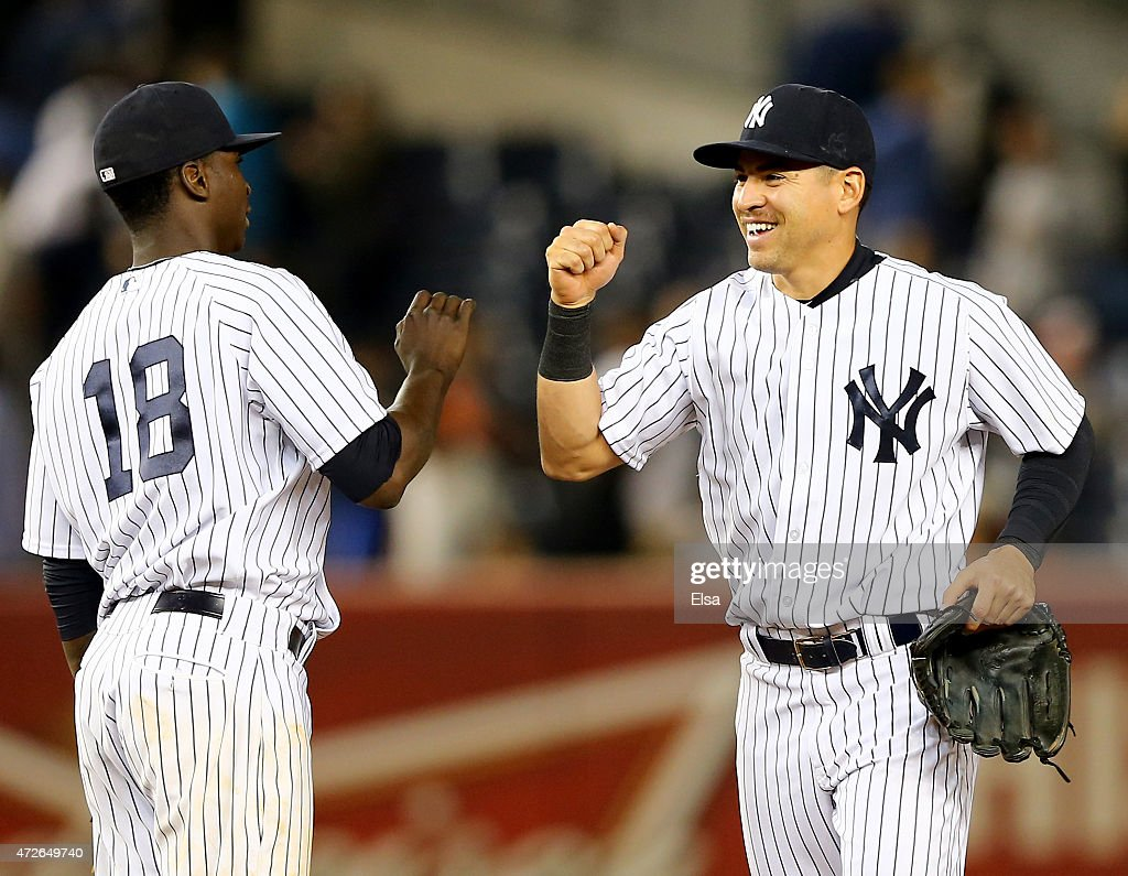 Didi Gregorius #18 and Jacoby Ellsbury #22 of the New York Yankees celebrate the win over the Baltimore Orioles on May 8, 2015 at Yankee Stadium in the Bronx borough of New York City.The New York Yankees defeated the Baltimore Orioles 5-4.