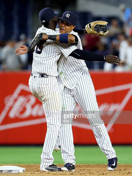 Didi Gregorius and Starlin Castro of the New York Yankees celebrate the 7-1 win over the Baltimore Orioles on July 19, 2016 at Yankee Stadium in the...