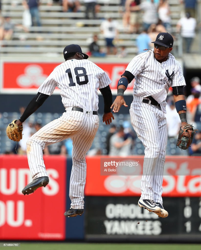 Didi Gregorius #18 and Starlin Castro #14 of the New York Yankees celebrate their 12-4 win against the Baltimore Orioles during their game at Yankee Stadium on April 29, 2017 in New York City.