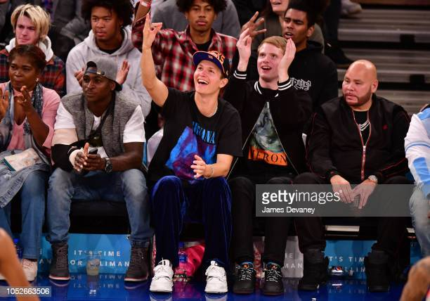 Didi Gregorius Ansel Elgort guest and Fat Joe attend the New York Knicks vs Boston Celtics game at Madison Square Garden on October 20 2018 in New...