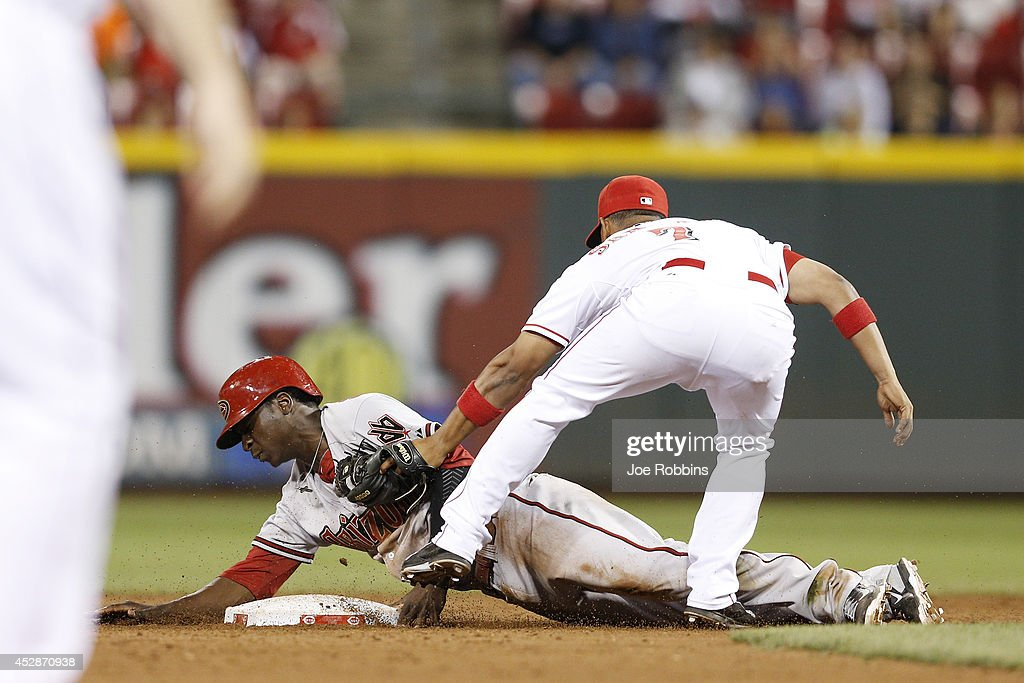 Didi Gregorius #1 of the Arizona Diamondbacks gets tagged out at second base by Ramon Santiago #7 of the Cincinnati Reds in the 13th inning of the game at Great American Ball Park on July 28, 2014 in Cincinnati, Ohio. The Diamondbacks won 2-1 in 15 innings.