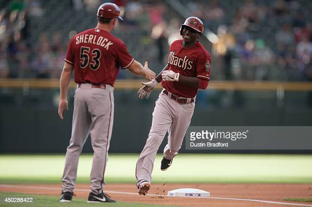 Didi Gregorius of the Arizona Diamondbacks is congratulated by third base coach Glenn Sherlock after hitting a leadoff home run in the first inning...