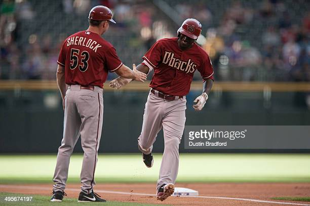 Didi Gregorius of the Arizona Diamondbacks is congratulated by third base coach Glenn Sherlock after hitting a leadoff home run in the first inning...