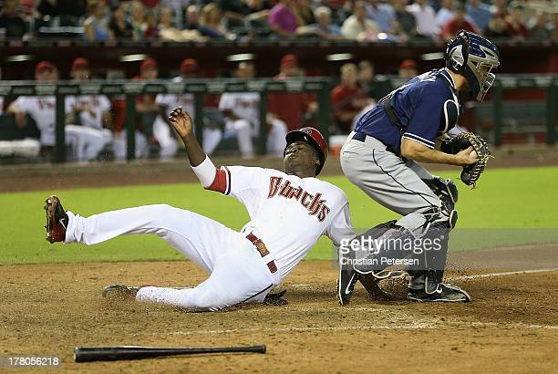 Didi Gregorius of the Arizona Diamondbacks is tagged out at home plate by catcher Nick Hundley of the San Diego Padres during the seventh inning of...