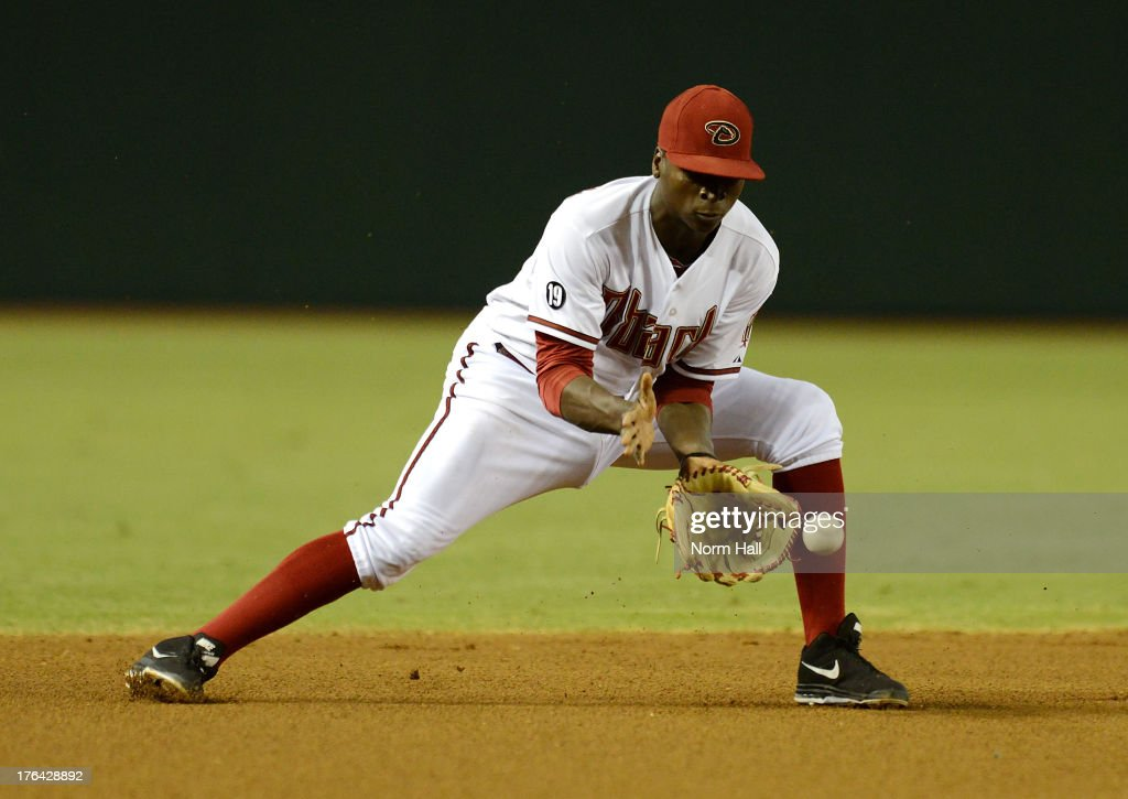 Didi Gregorius #1 of the Arizona Diamondbacks makes a play on a ground ball against the Baltimore Orioles at Chase Field on August 12, 2013 in Phoenix, Arizona.