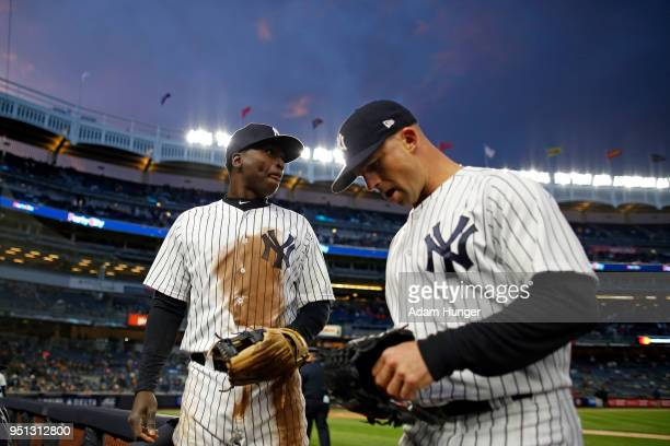 Didi Gregorius of the New York Yankees and Brett Gardner of the New York Yankees in action against the Toronto Blue Jays during the third inning at...