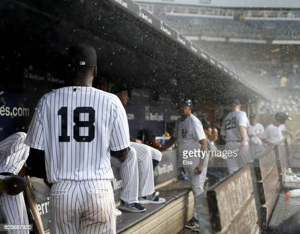 Didi Gregorius of the New York Yankees and the rest of his teammates head for the clubhouse as rain delays the game against the Detroit Tigers on...