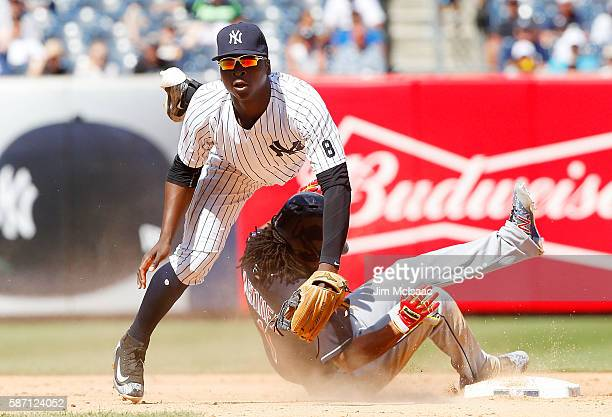 Didi Gregorius of the New York Yankees attempts a seventh inning double play after forcing out pinch runner Michael Martinez of the Cleveland Indians...