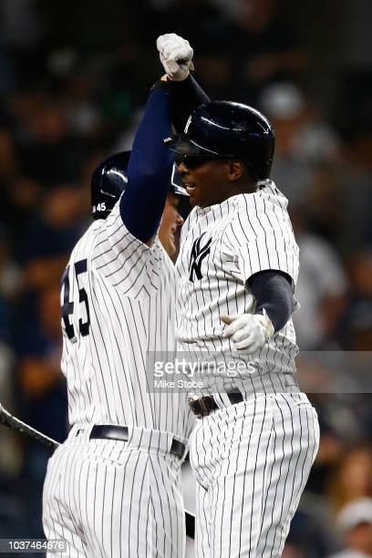 Didi Gregorius of the New York Yankees celebrates after connecting on a tworun home run in the first inning against the Baltimore Orioles at Yankee...