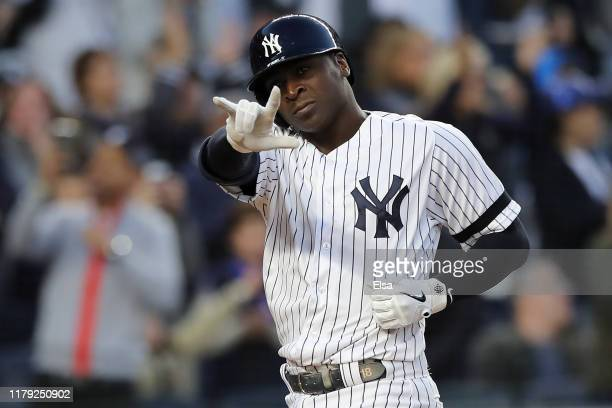 Didi Gregorius of the New York Yankees celebrates after his grand slam home run off Tyler Duffey of the Minnesota Twins in the third inning in game...