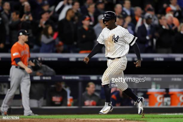 Didi Gregorius of the New York Yankees celebrates as he scores in the eighth inning against the Houston Astros during Game Four of the American...