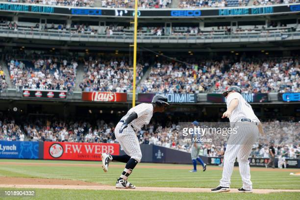 Didi Gregorius of the New York Yankees celebrates his first inning two run home run against Sean Reid-Foley of the Toronto Blue Jays with third base...