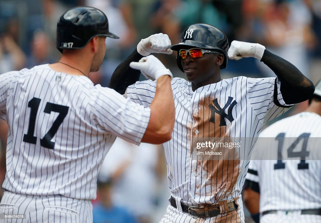 Didi Gregorius #18 of the New York Yankees celebrates his second inning home run against the Baltimore Orioles with teammates Matt Holliday #17 at Yankee Stadium on September 17, 2017 in the Bronx borough of New York City.