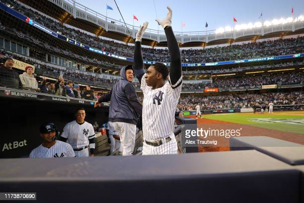 Didi Gregorius of the New York Yankees celebrates in the dugout after hitting a grand slam in the third inning during the ALDS Game 2 between the...