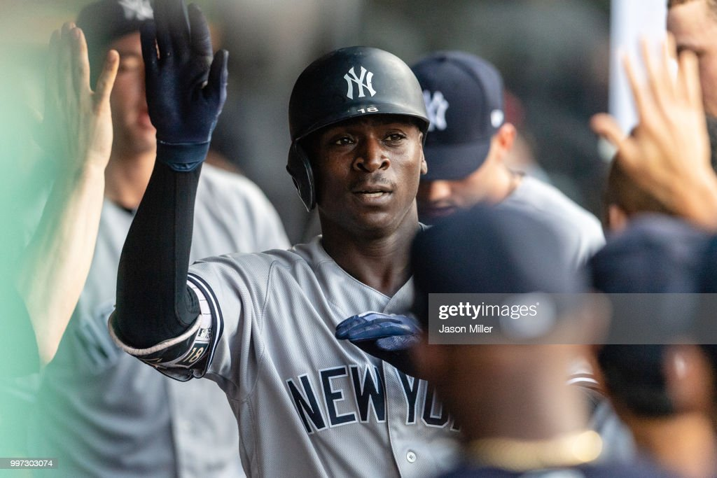 Didi Gregorius #18 of the New York Yankees celebrates in the dugout after hitting a solo homer during the fourth inning against the Cleveland Indians at Progressive Field on July 12, 2018 in Cleveland, Ohio.