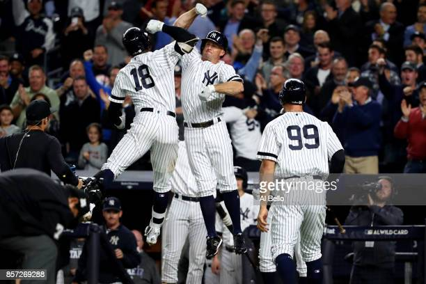 Didi Gregorius of the New York Yankees celebrates with Brett Gardner after hitting a three run home run against Ervin Santana of the Minnesota Twins...