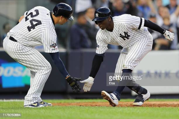 Didi Gregorius of the New York Yankees celebrates with Gary Sanchez after his grand slam home run off Tyler Duffey of the Minnesota Twins in the...