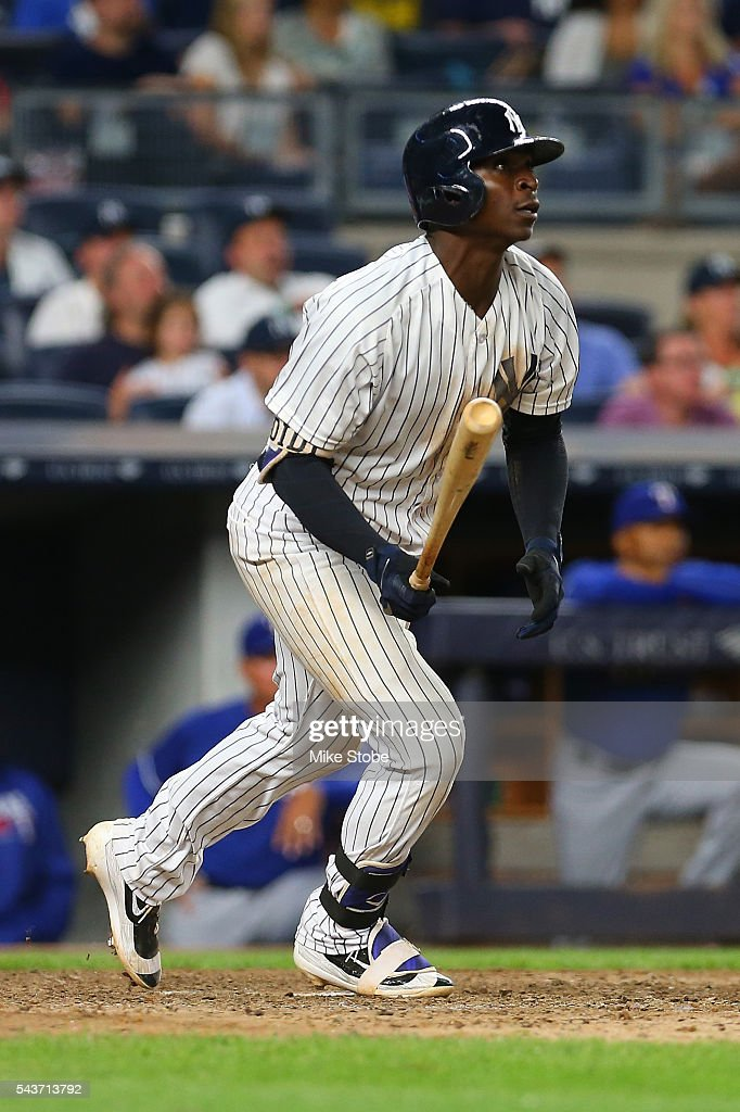 Didi Gregorius #18 of the New York Yankees connects on a game winning two-run home run in the bottom of the ninth inning against the Texas Rangers at Yankee Stadium on June 29, 2016 in the Bronx borough of New York City. Yankees defeated the Rangers 9-7