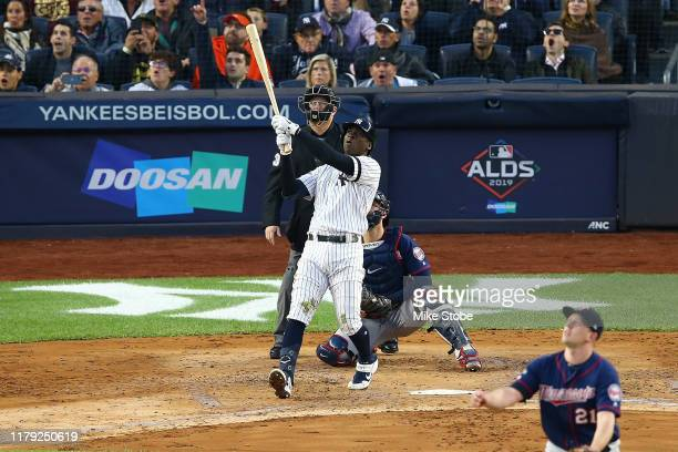 Didi Gregorius of the New York Yankees connects on a grand slam home run in the third inning against the Minnesota Twins during game two of the...