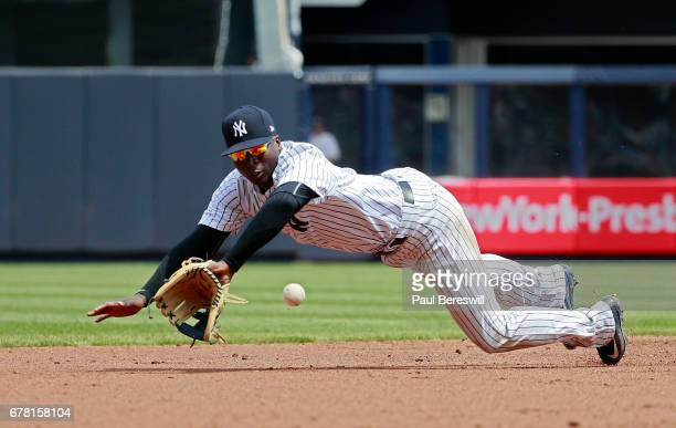 Didi Gregorius of the New York Yankees dives for a ball during an MLB baseball game against the Baltimore Orioles on April 29 2017 at Yankee Stadium...