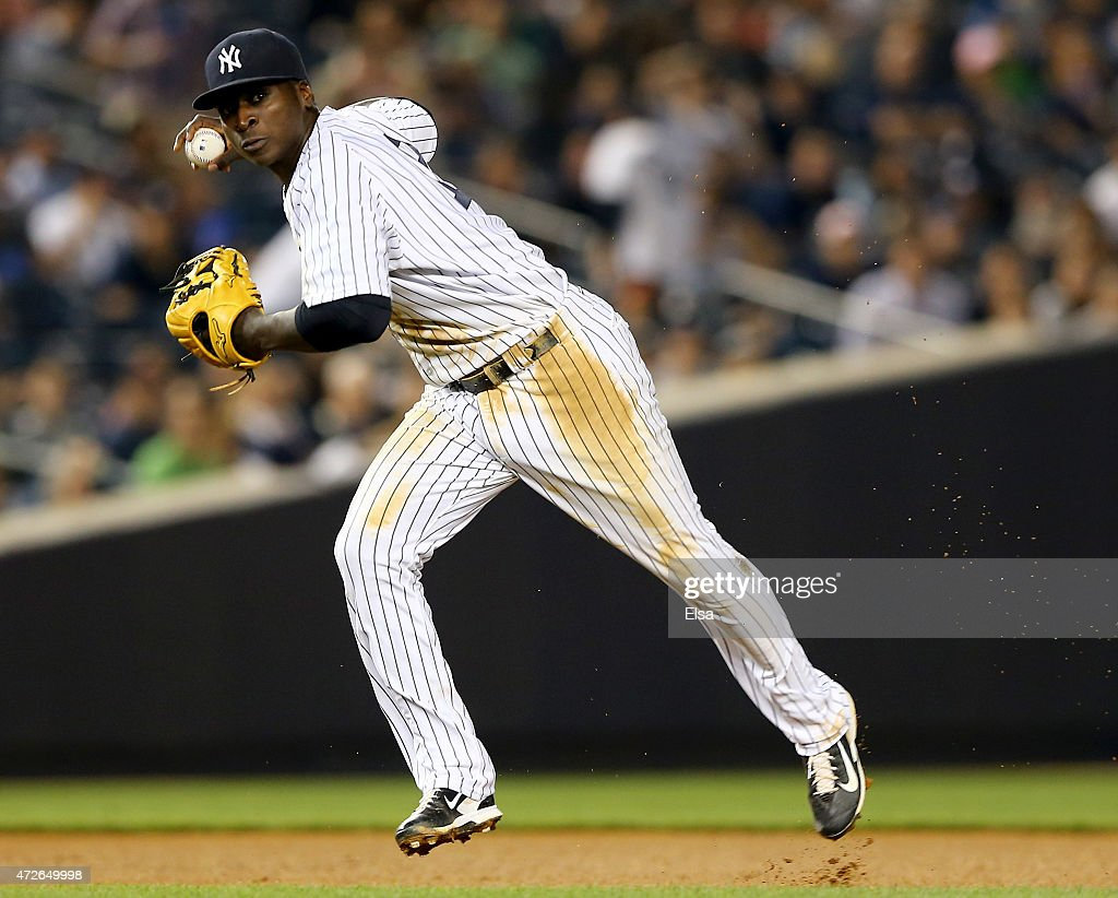 Didi Gregorius #18 of the New York Yankees fields a hit by J.J. Hardy of the Baltimore Orioles in the eighth inning on May 8, 2015 at Yankee Stadium in the Bronx borough of New York City.The New York Yankees defeated the Baltimore Orioles 5-4.