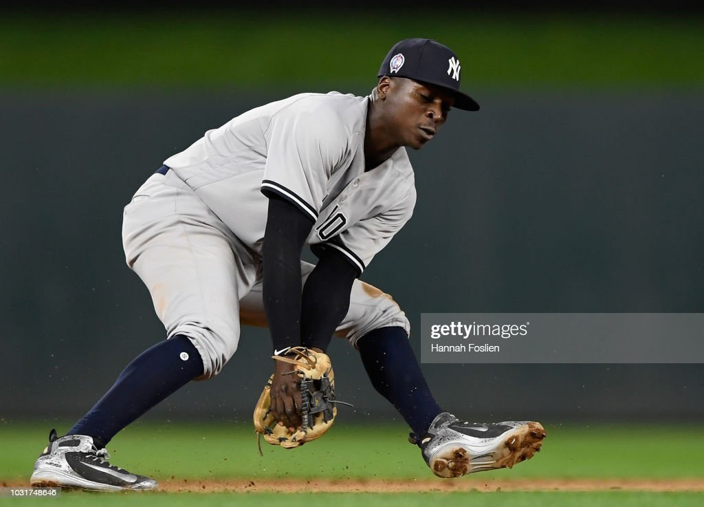 Didi Gregorius #18 of the New York Yankees fields the ball hit by Logan Forsythe #24 of the Minnesota Twins at shortstop during the fifth inning of the game on September 11, 2018 at Target Field in Minneapolis, Minnesota.