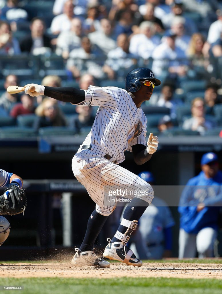 Didi Gregorius #18 of the New York Yankees follows through on a sixth inning RBI single against the Toronto Blue Jays at Yankee Stadium on April 21, 2018 in the Bronx borough of New York City.