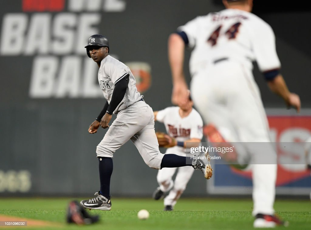 Didi Gregorius #18 of the New York Yankees heads to second base as the ball hit by teammate Greg Bird #33 gets past Kyle Gibson #44 of the Minnesota Twins during the second inning of the game on September 10, 2018 at Target Field in Minneapolis, Minnesota. Bird was out at first base on the play. The Yankees defeated the Twins 7-2.