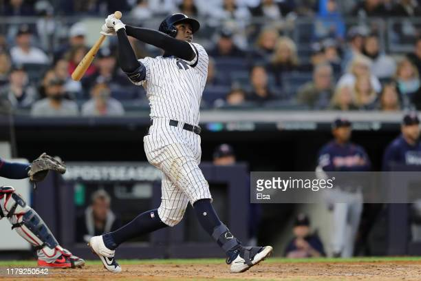 Didi Gregorius of the New York Yankees hits a grand slam home run off Tyler Duffey of the Minnesota Twins in the third inning in game two of the...
