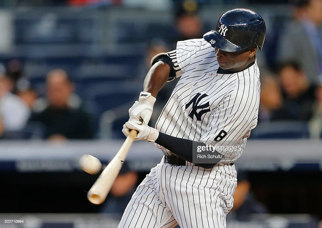 Didi Gregorius #18 of the New York Yankees hits a home run during the second inning against the Oakland Athletics at Yankee Stadium on April 20, 2016 in the Bronx borough of New York City.