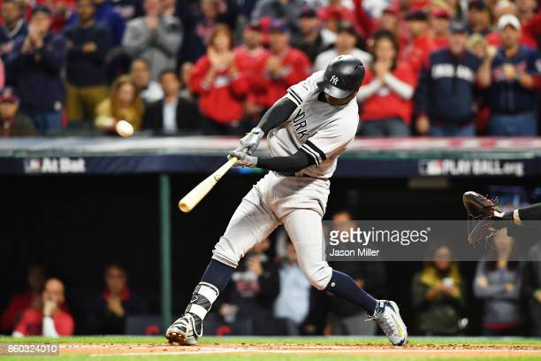 Didi Gregorius of the New York Yankees hits a solo homerun in the first inning against the Cleveland Indians in game five of the American League...