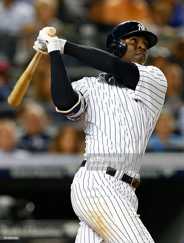 Didi Gregorius #18 of the New York Yankees hits a three run home run in the sixth inning against the Toronto Blue Jays during a MLB baseball game at Yankee Stadium on September 11, 2015 in the Bronx borough of New York City.
