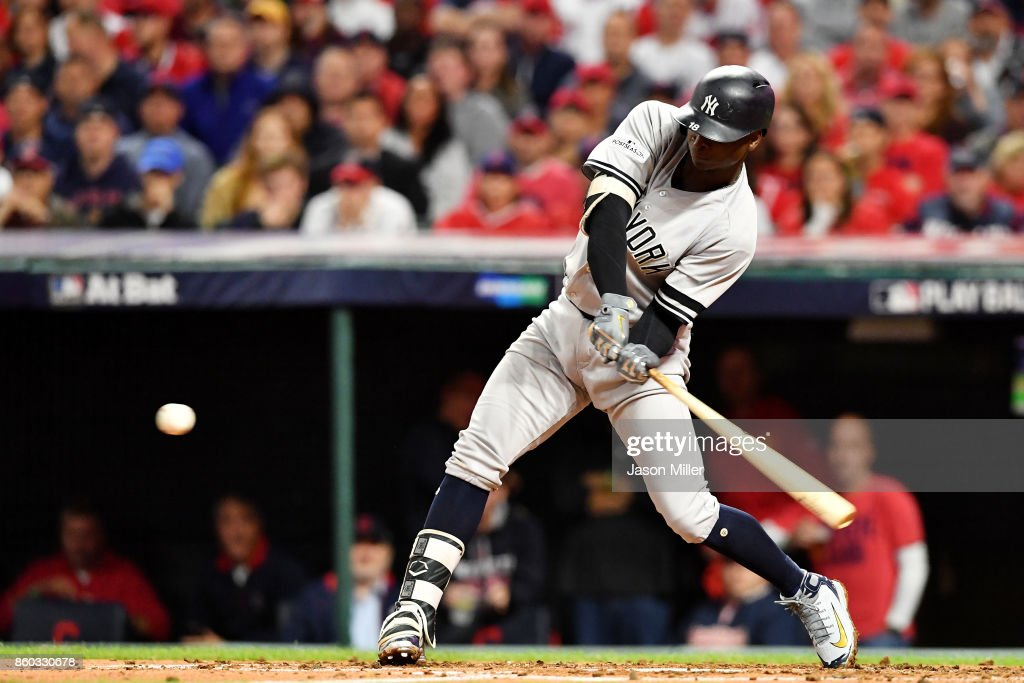 Didi Gregorius #18 of the New York Yankees hits a two-run homerun in the third inning against the Cleveland Indians in game five of the American League Divisional Series at Progressive Field on October 11, 2017 in Cleveland, Ohio.