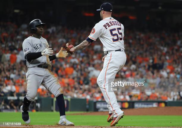 Didi Gregorius of the New York Yankees is tagged out by Ryan Pressly of the Houston Astros during the third inning in game six of the American League...