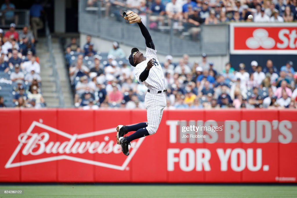 Didi Gregorius #18 of the New York Yankees jumps but is unable to catch the ball in the third inning of a game against the Tampa Bay Rays at Yankee Stadium on July 29, 2017 in the Bronx borough of New York City.