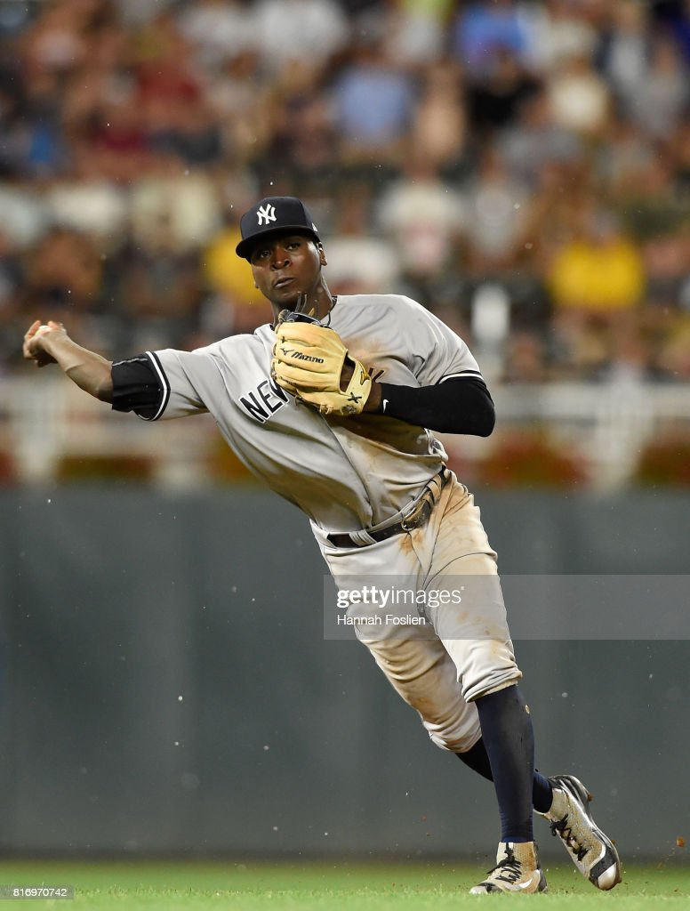 Didi Gregorius #18 of the New York Yankees makes a play at shortstop to get out Brian Dozier #2 of the Minnesota Twins at first base during the eighth inning of the game on July 17, 2017 at Target Field in Minneapolis, Minnesota. The Twins defeated the Yankees 4-2.