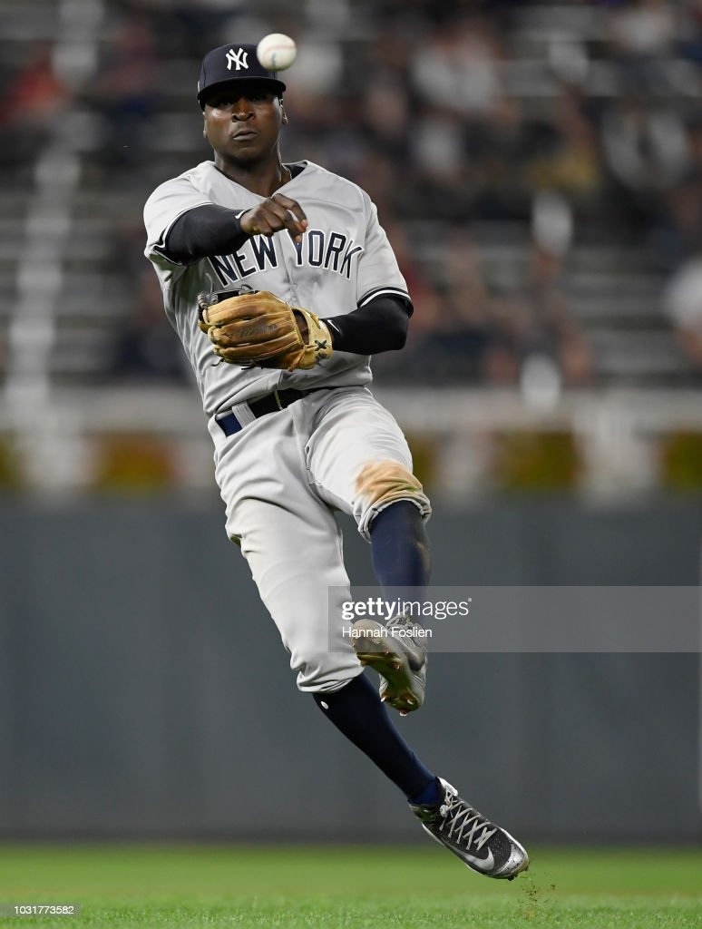 Didi Gregorius #18 of the New York Yankees makes a play to get out Tyler Austin #31 of the Minnesota Twins at first base during the eighth inning of the game on September 11, 2018 at Target Field in Minneapolis, Minnesota. The Twins defeated the Yankees 10-5.
